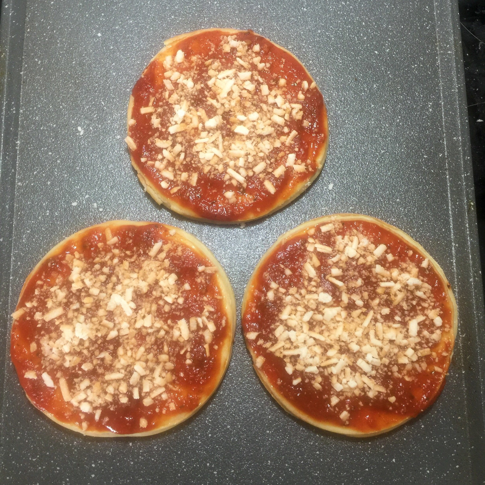 cheese on the mini pizzas