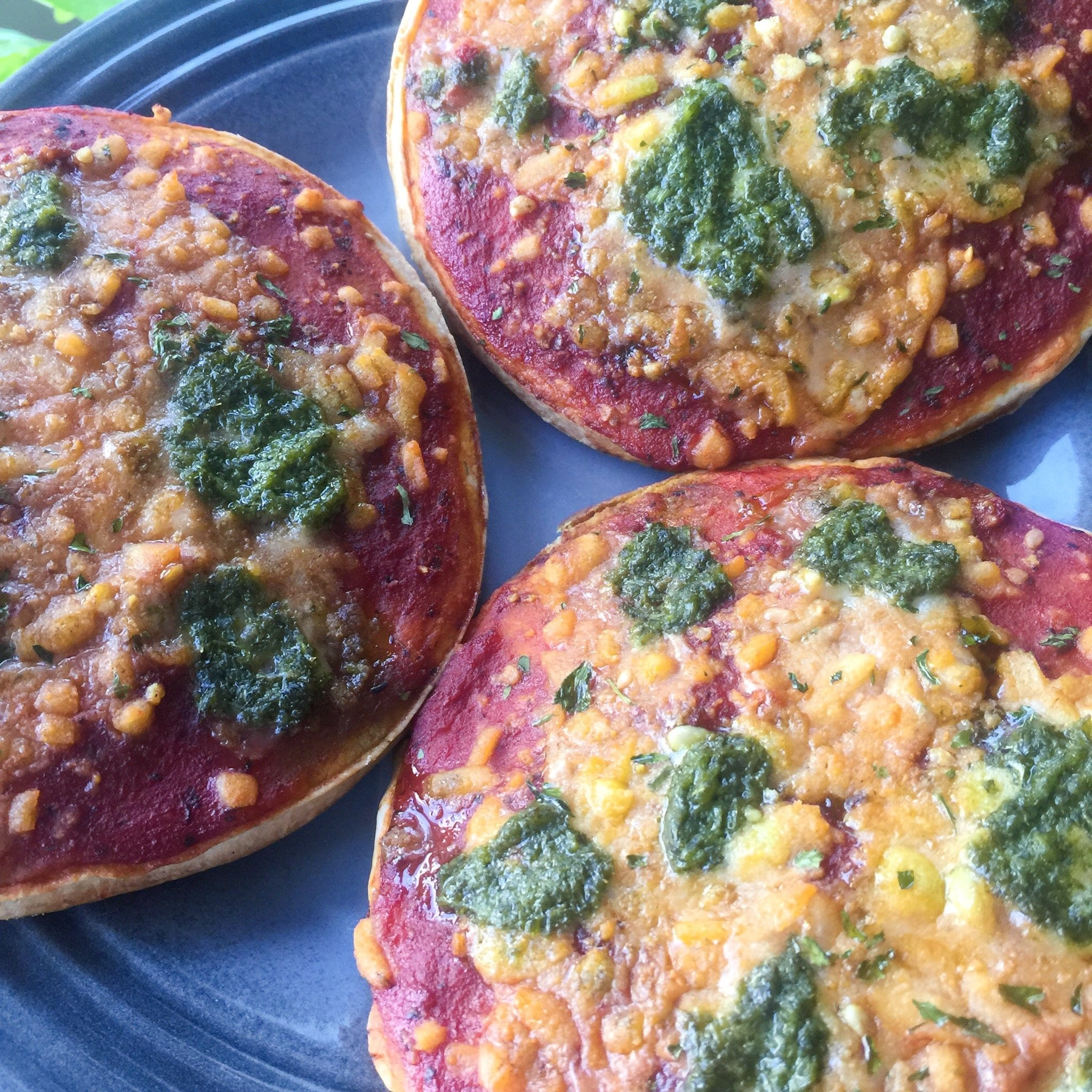 vegan cheese and pesto pizzas