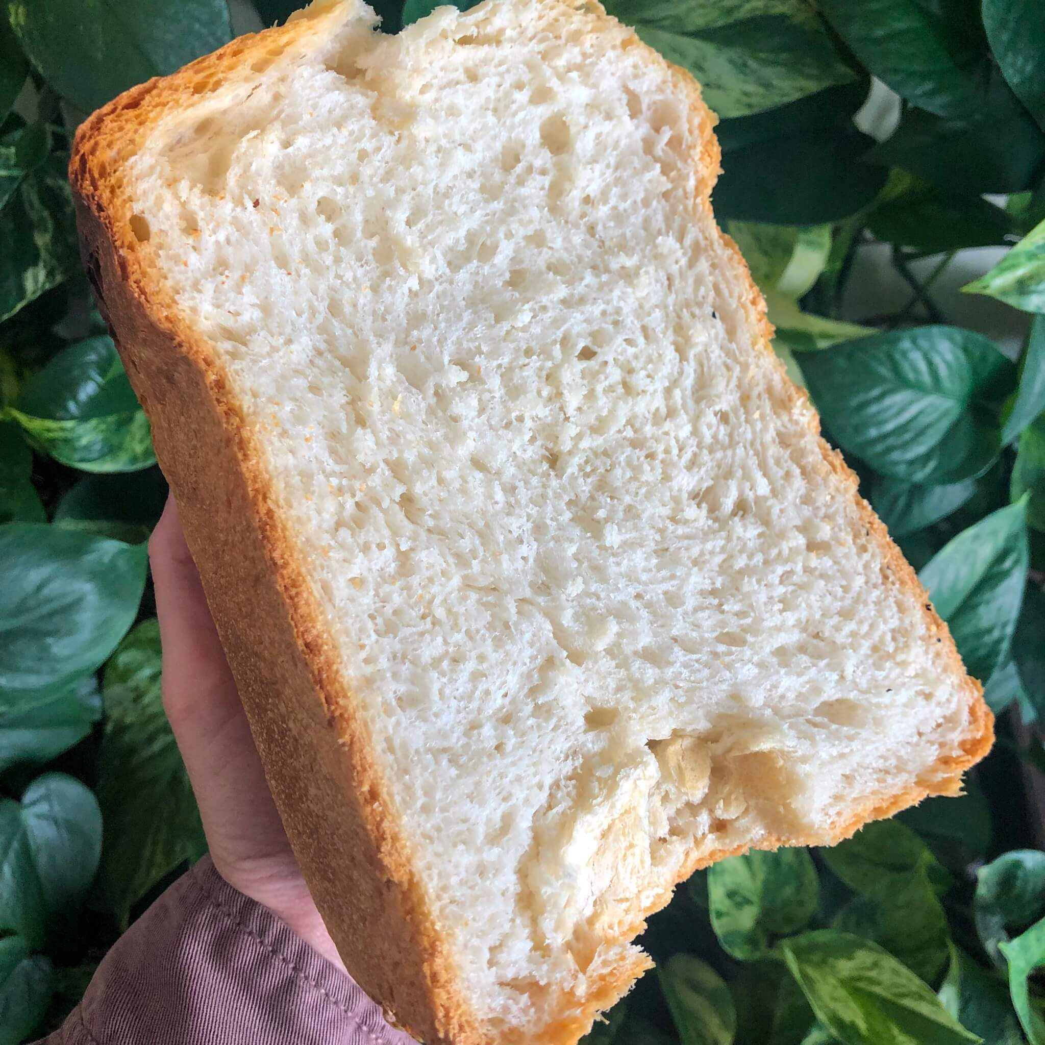 half a loaf of vegan white bread from a bread maker