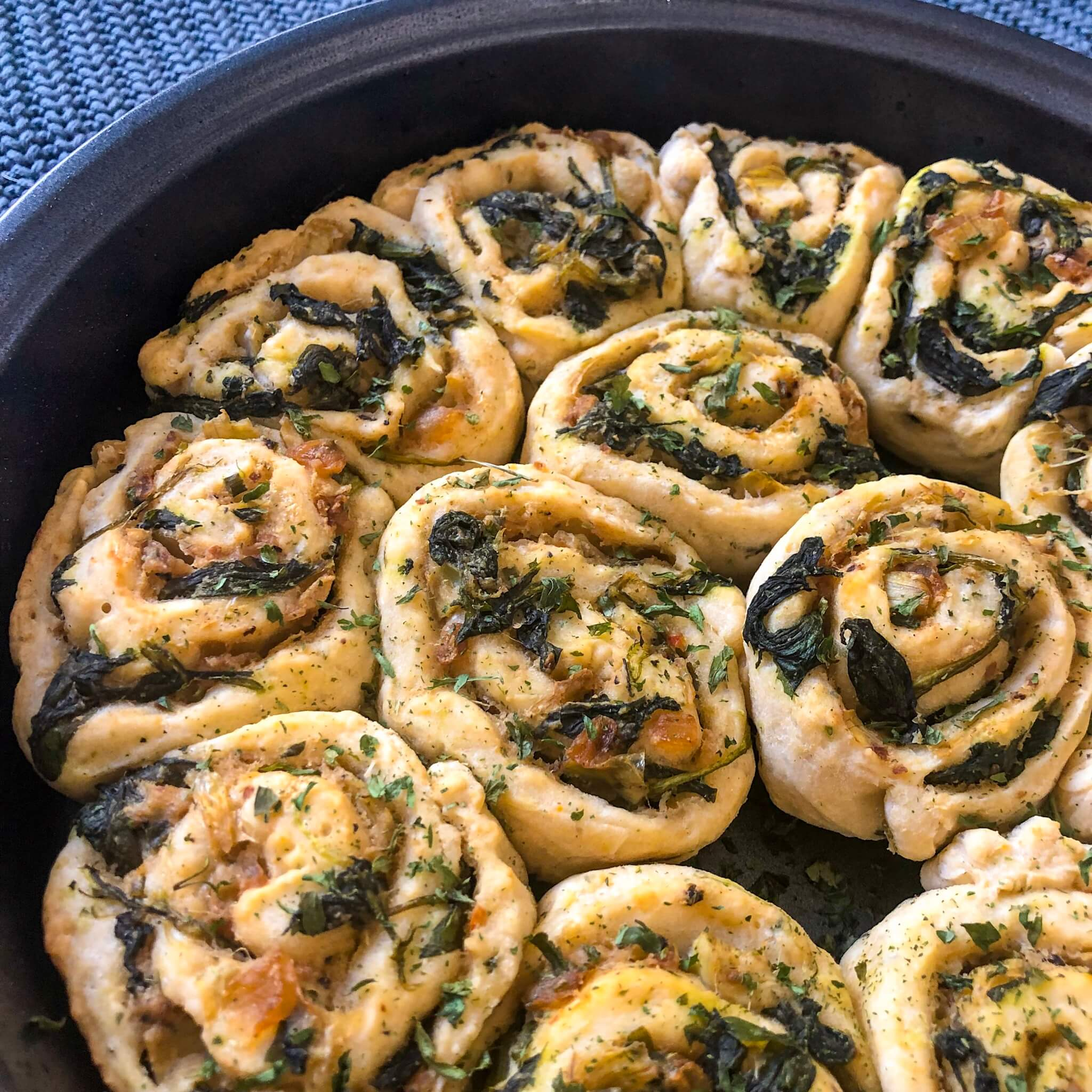 spinach and artichoke rolls cooked up close