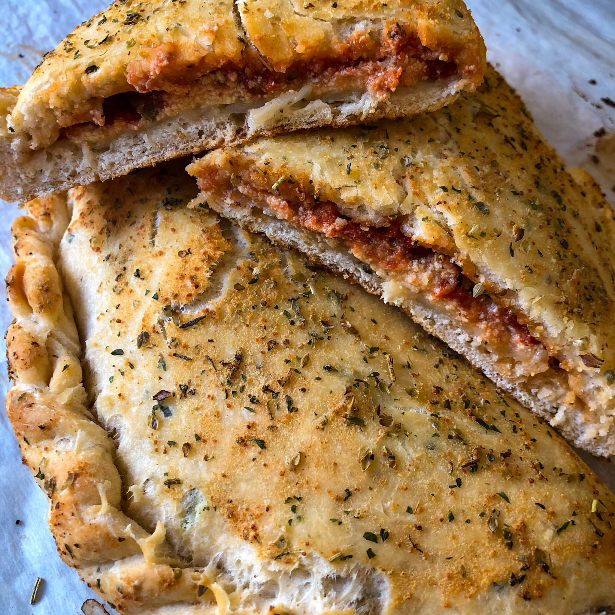 calzones cut open looking like a pizza pocket