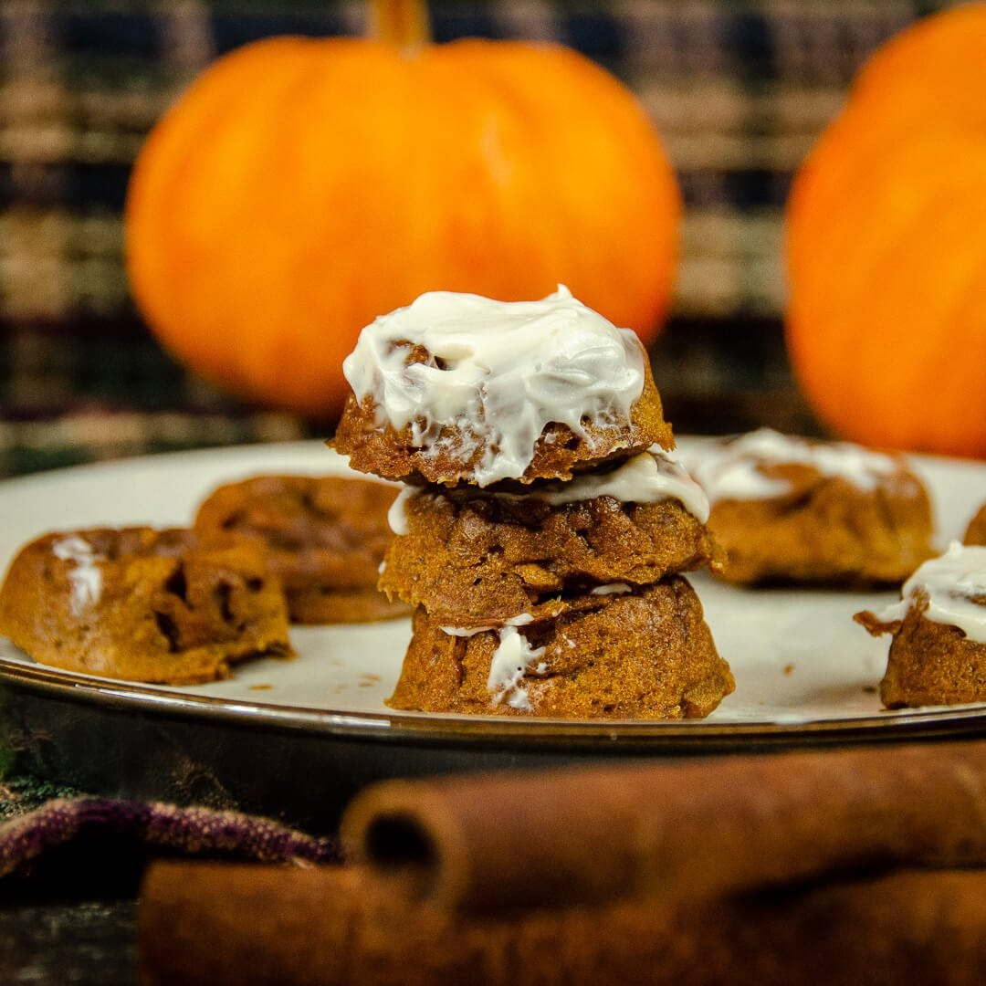 mini pumpkin donuts with cream cheese stacked