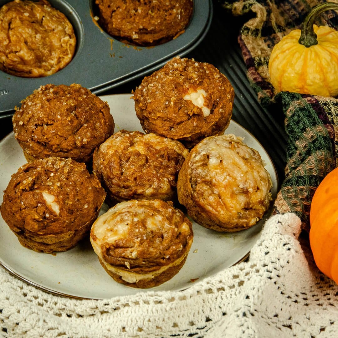 pumpkin muffins with vegan maple cream cheese on plate