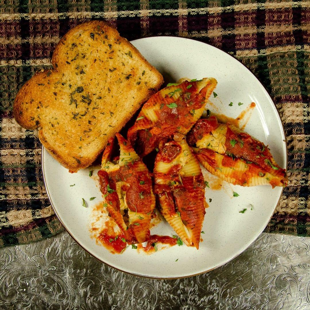 vegan shells with vegan garlic bread on plate