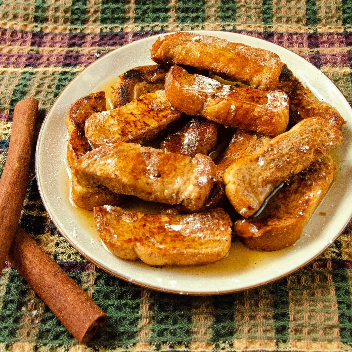 french toast sticks with maple syrup up close