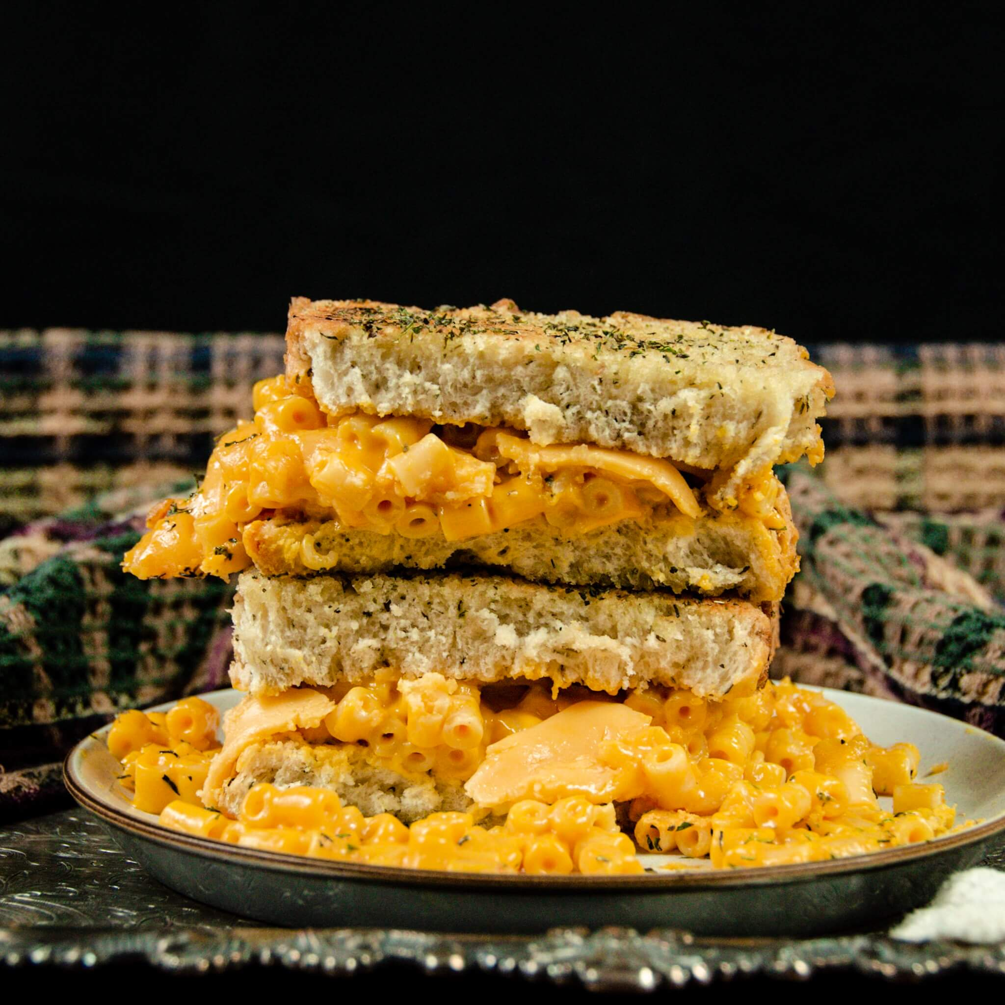 grilled cheese cut open with vegan mac and cheese