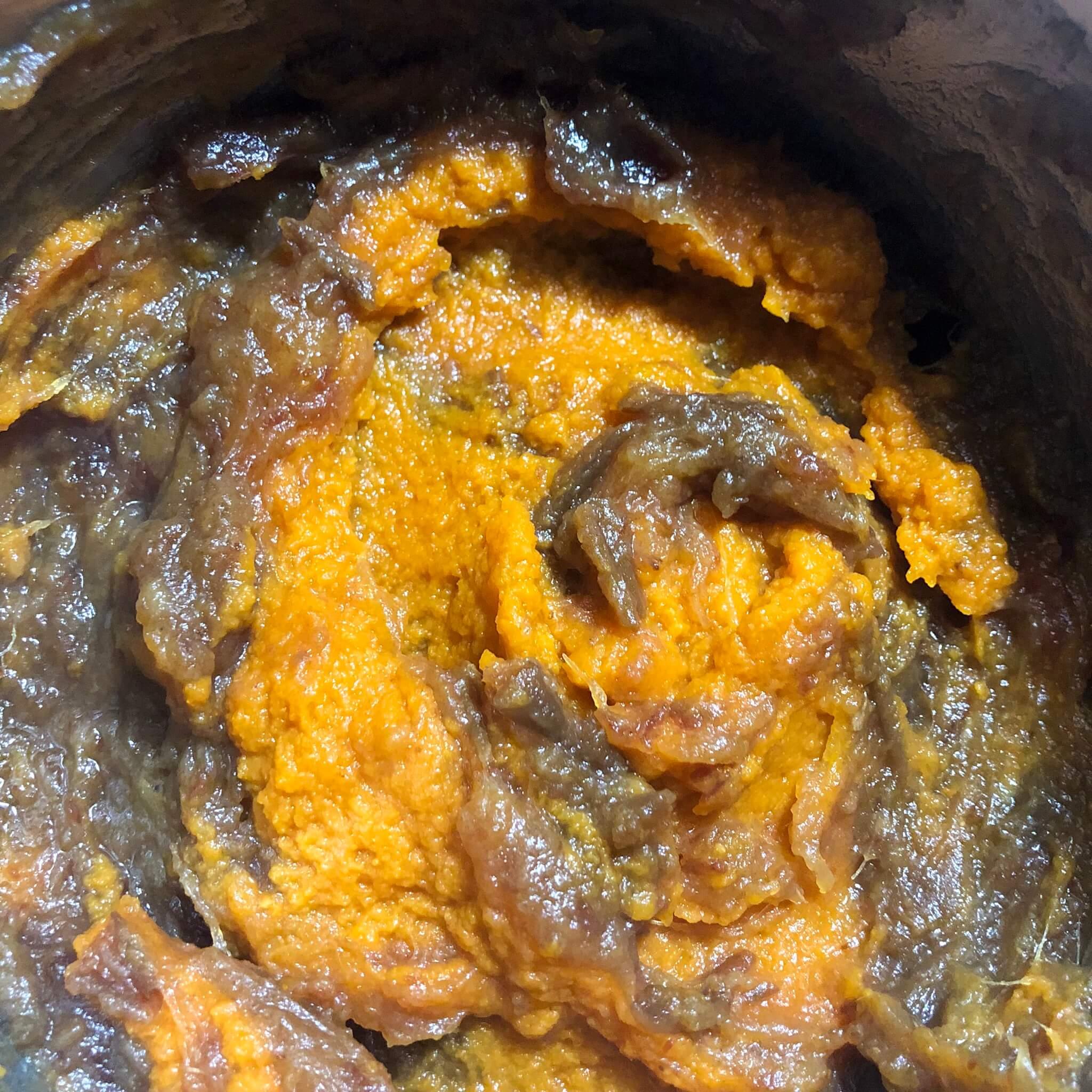 pumpkin being mixed in to vegan date squares recipe