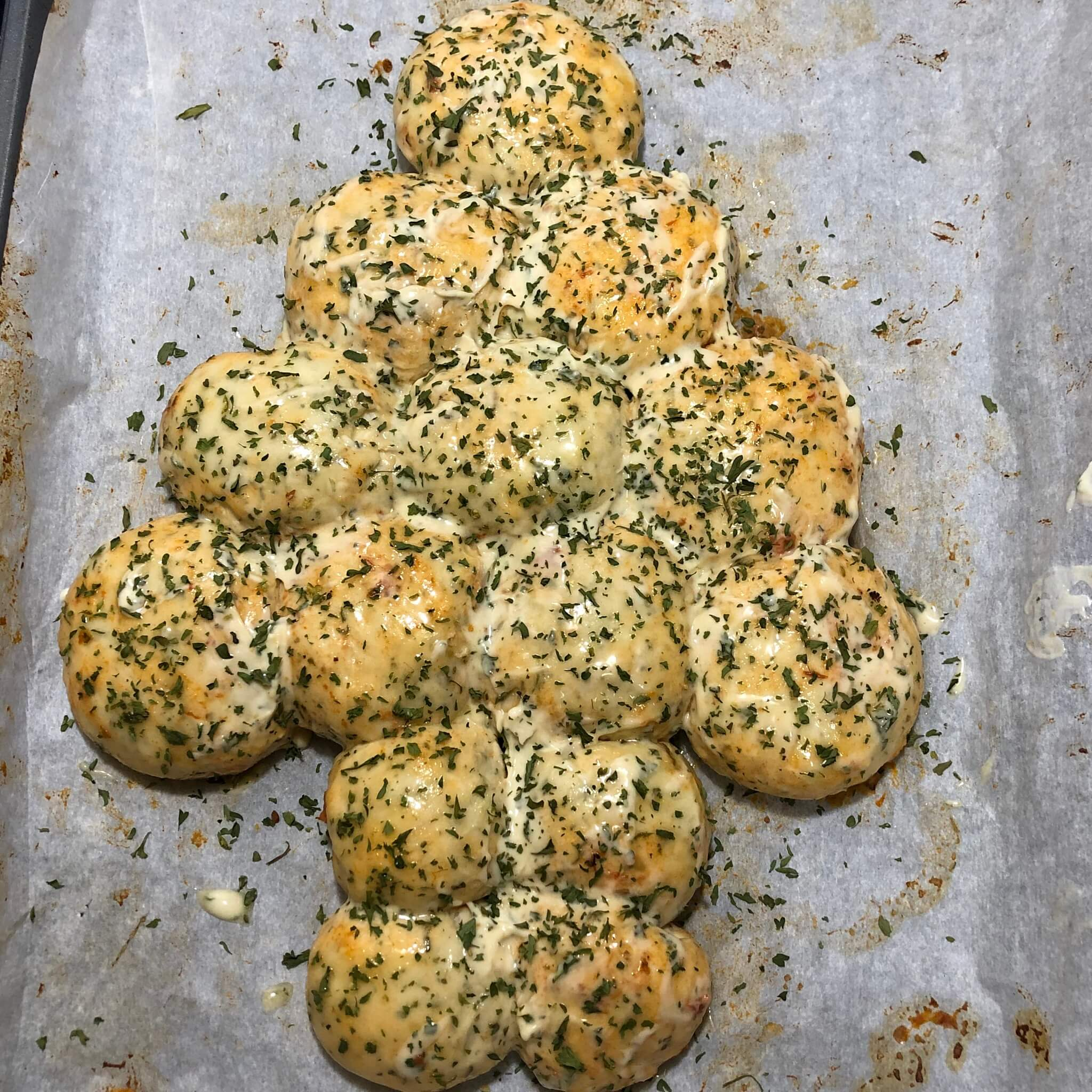 raw pull apart garlic bread with spread top