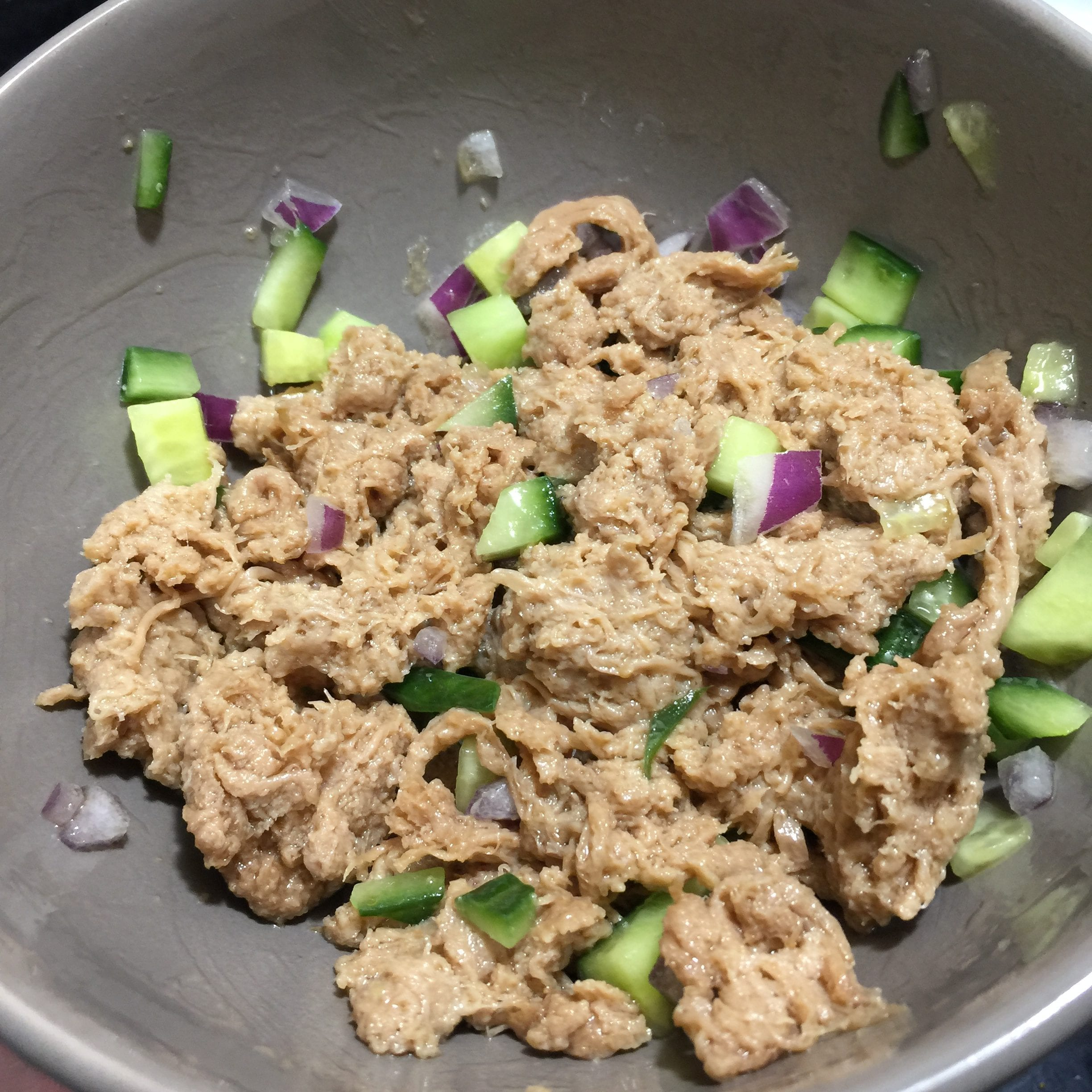 vegan tuna mixed with cucumber and red onion